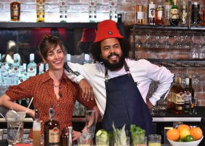 Jillionaire (R) of Major LaZer mixes up a custom cocktail with renowned New York bartender Ivy Mix (L) during the BACARDI Legacy fuel the hustle roundtable discussion in San Francisco, Calif. on April 25, 2016. (Josh Edelson/AP Images for BACARDI)
