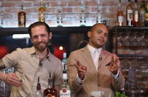 Walshy Fire mixes up a custom cocktail with renowned New-York bartender Steve-Schneider during the BACARDI Legacy Fuel the Hustle roundtable-discussion in San Francisco, Calif. on April 25, 2016. (Josh Edelson/AP Images for BACARDI)